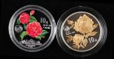 1999年昆明世界园艺博览会-月季花镀金1盎司普制银币、山茶花1盎司精制彩银币各一枚,共二枚(原盒、部分带证书)