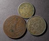 西藏铜币、民国27年蒙疆银行五角、康德七年伪满洲国壹角各一枚,共三枚